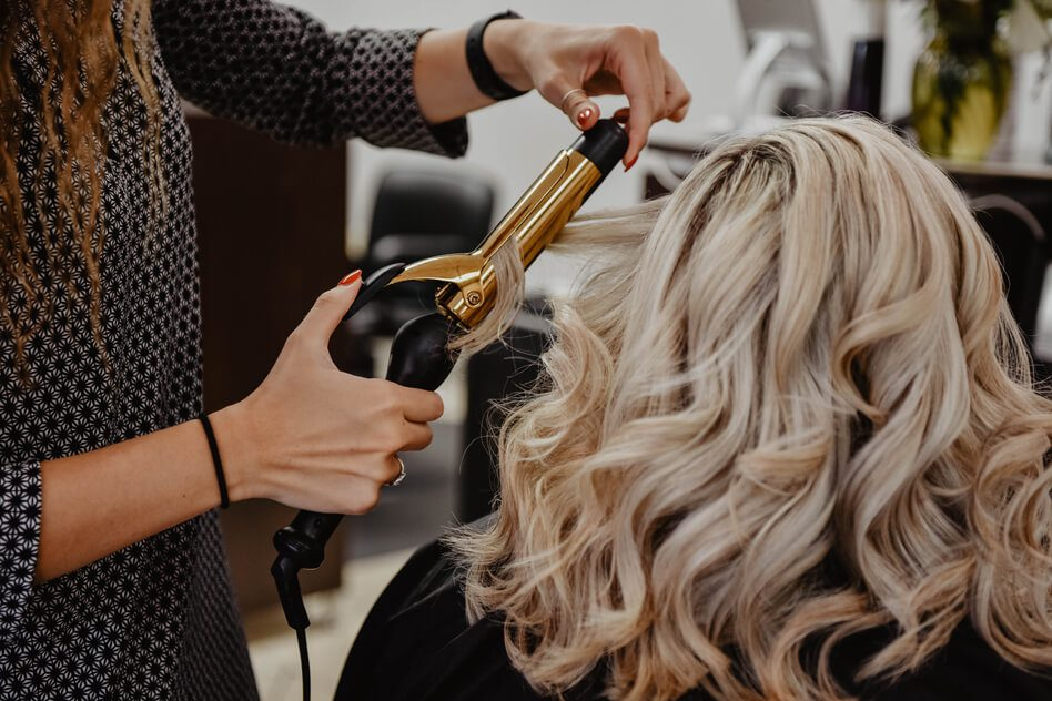 woman getting her hair done at a salon, spa